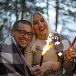 Young couple holding sparklers
