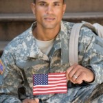 Soldier holding american flag
